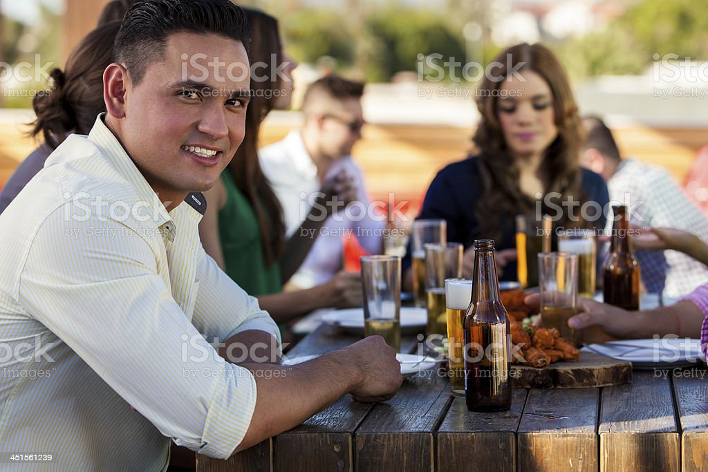 Handsome man with his friends royalty-free stock photo