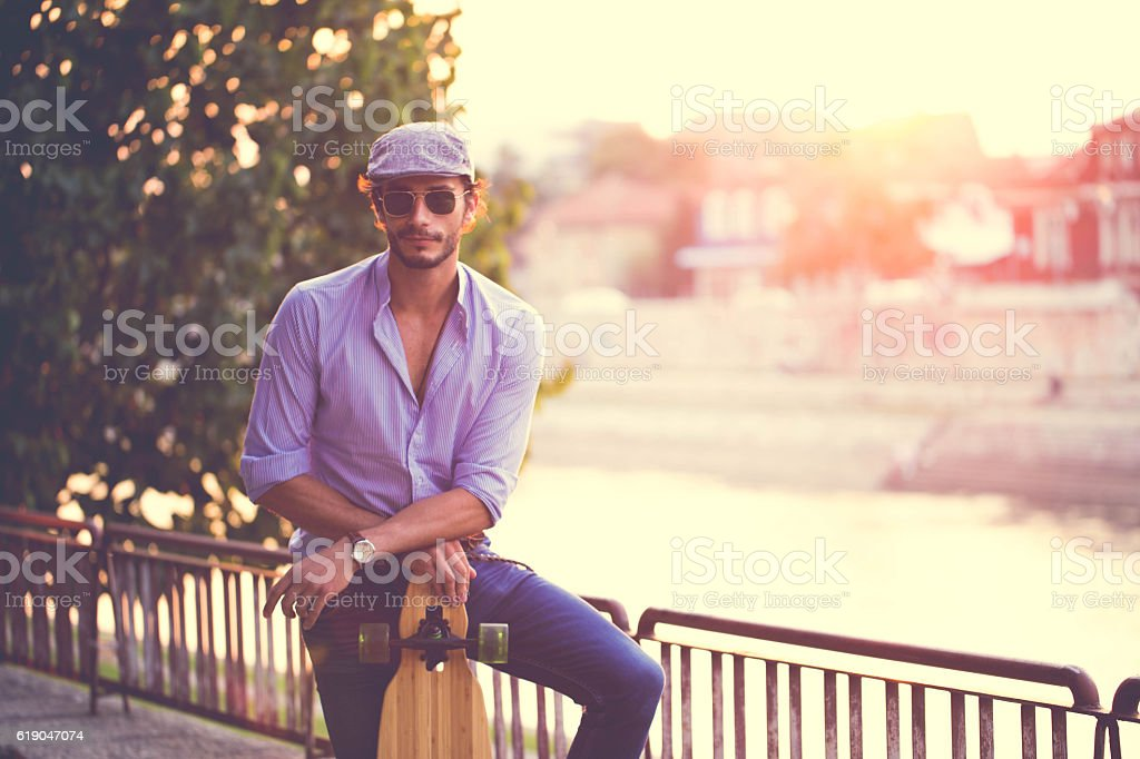 Handsome man with Longboard stock photo