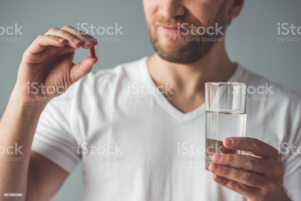 Handsome man with medicine stock photo