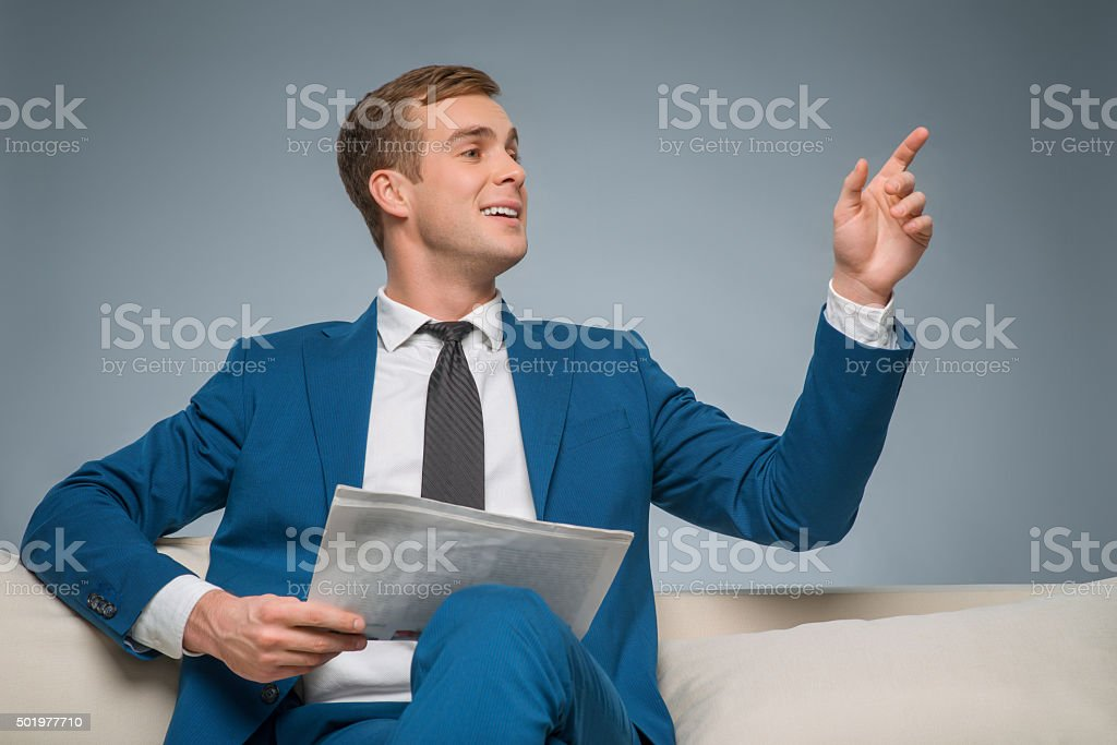 Handsome man with newspaper stock photo