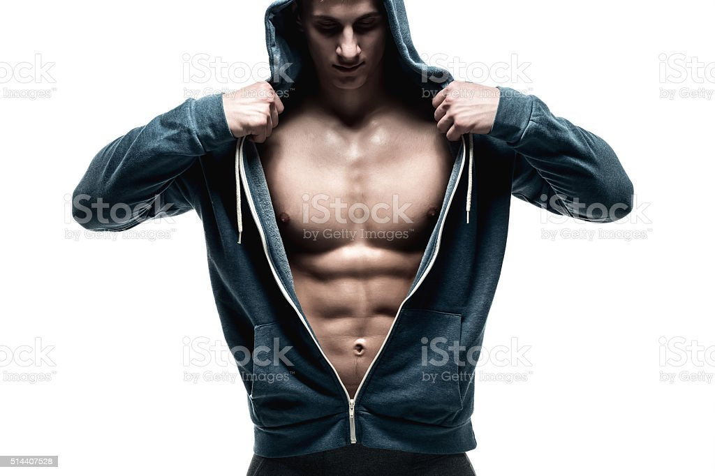 Handsome man with open jacket revealing muscular chest and abs stock photo