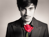 Handsome man with single rose