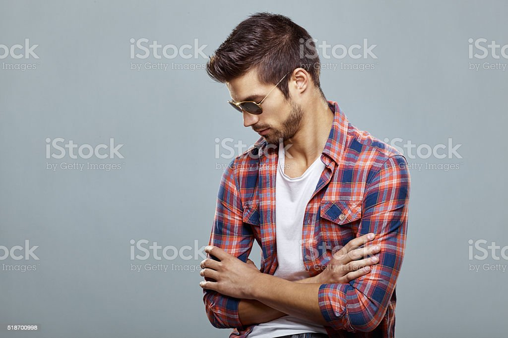 Handsome man with sunglasses and nice hairstyle stock photo