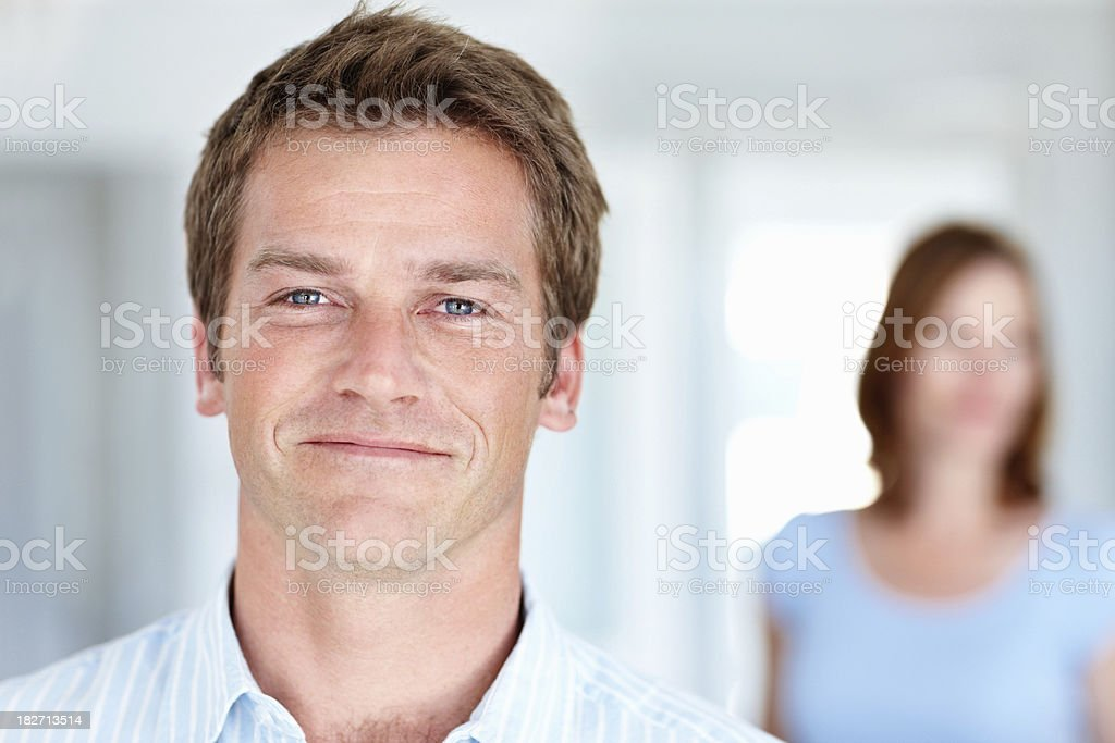 Handsome man with wife in the background royalty-free stock photo