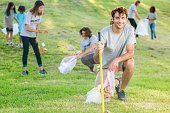 Handsome man works with team to clean up community