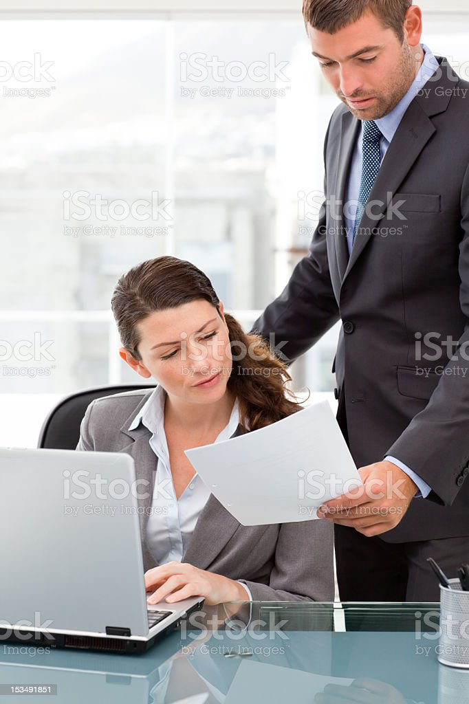 Handsome manager showing a paper royalty-free stock photo