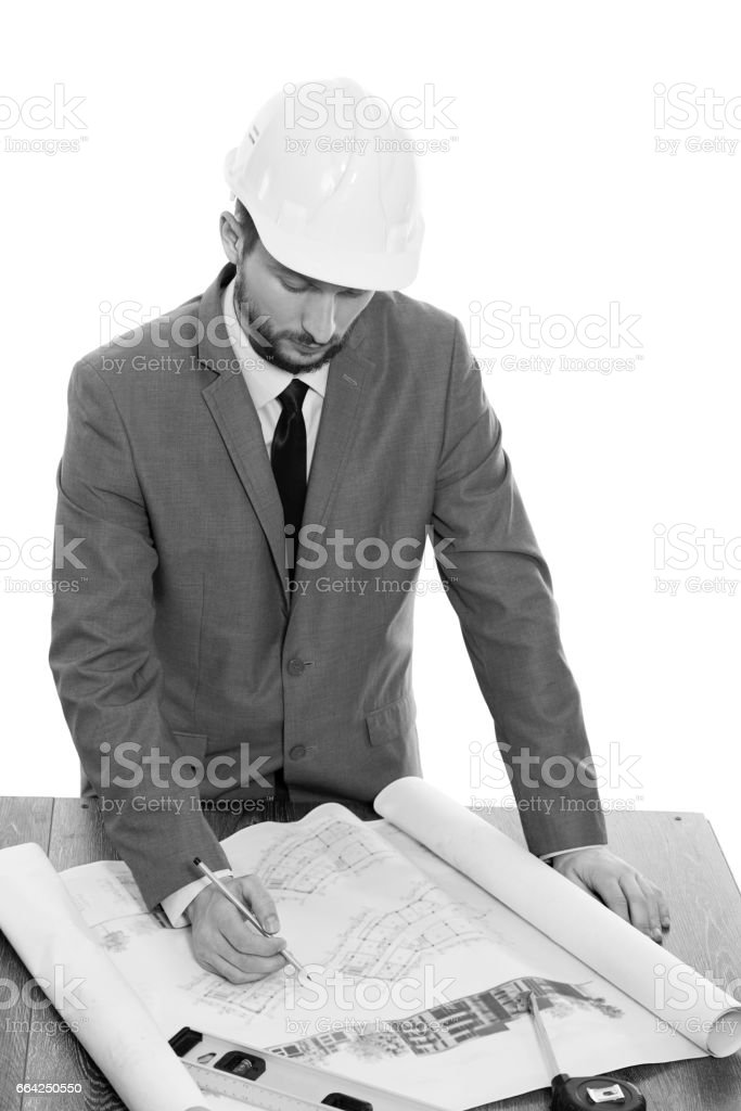 Handsome mature contractor drawing a building plan stock photo