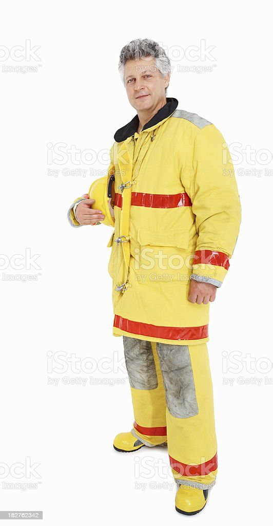 Handsome mature fire fighter standing isolated against white royalty-free stock photo