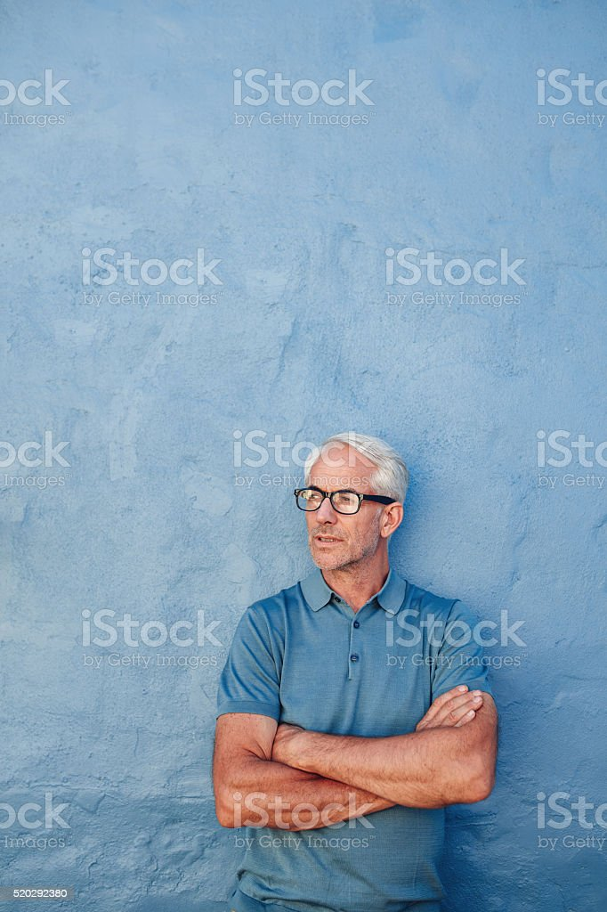 Handsome mature man looking at copy space stock photo