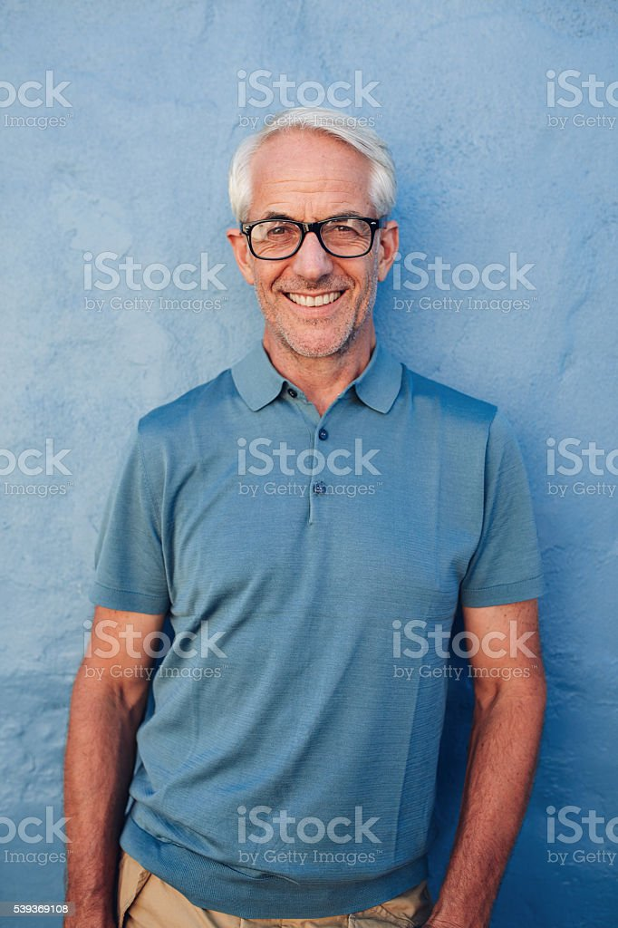 Handsome mature man smiling at camera stock photo