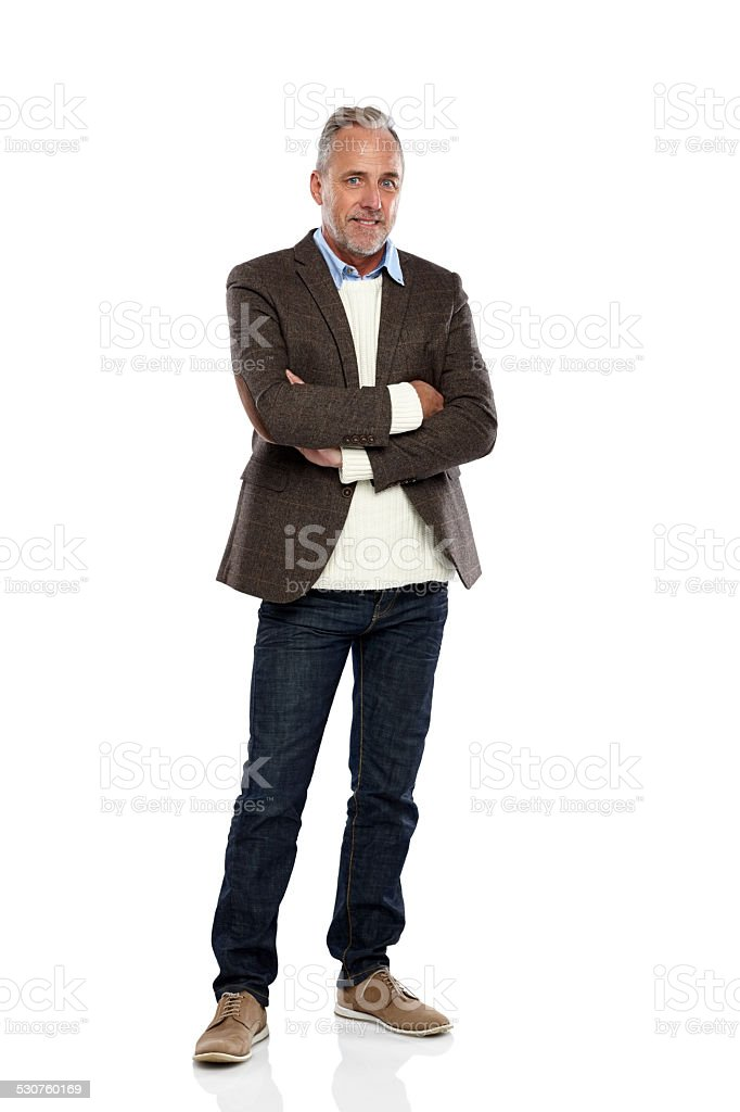 Handsome mature man standing confidently stock photo