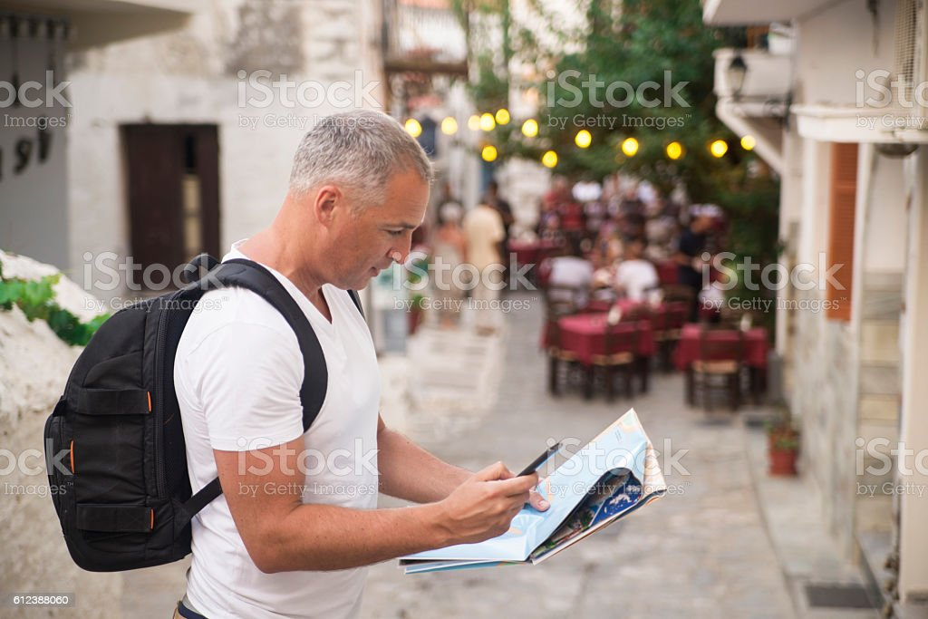 Handsome mature man studying a map stock photo