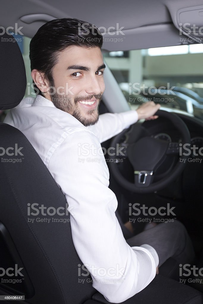 Handsome men in a car stock photo