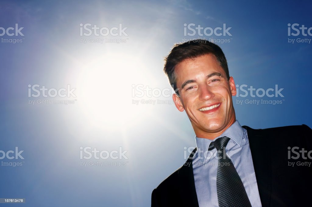 Handsome mid adult  business man looking at you against sky royalty-free stock photo