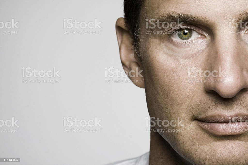 Handsome middle aged man with green eyes in a 3/4 face shot royalty-free stock photo