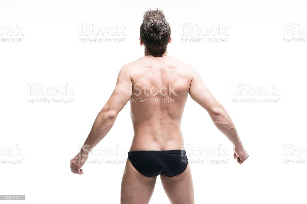 Handsome muscular bodybuilder posing on white background stock photo