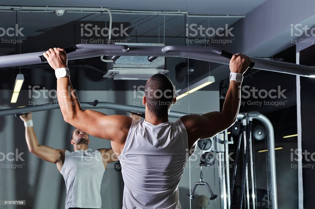 Handsome Muscular Male Model With Perfect Body Doing Pull Ups stock photo