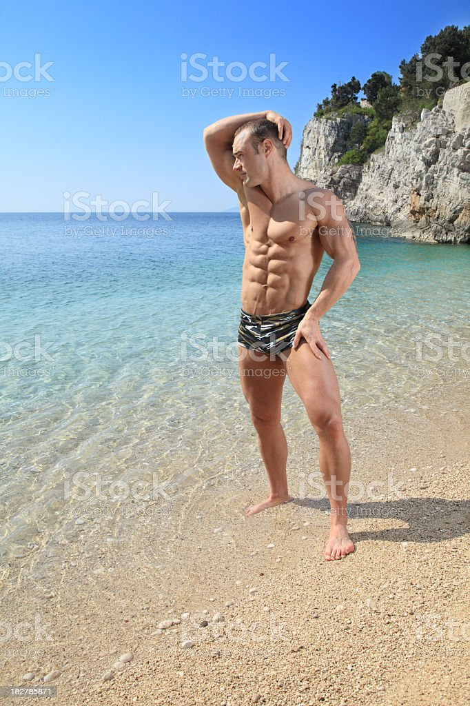 Handsome Muscular Male on the Beach royalty-free stock photo