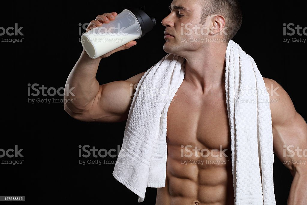 Handsome muscular male with protein shake royalty-free stock photo
