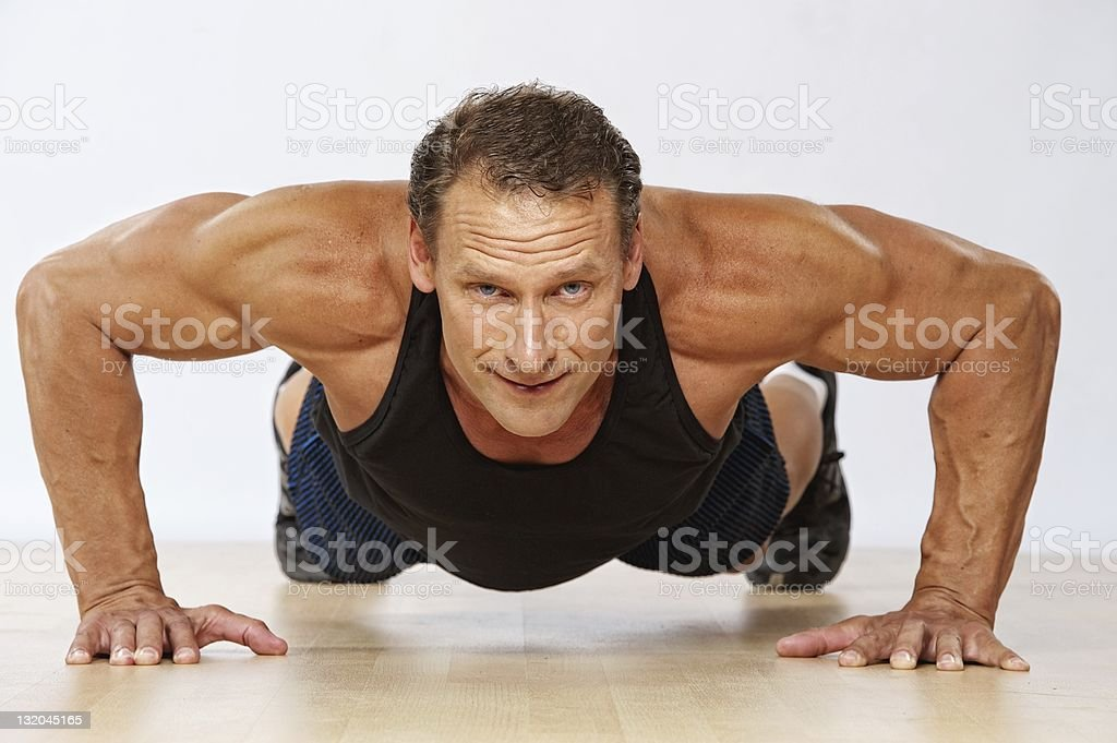 Handsome muscular man doing push-up. royalty-free stock photo