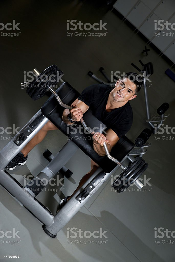 Handsome muscular man exercising in Gym royalty-free stock photo