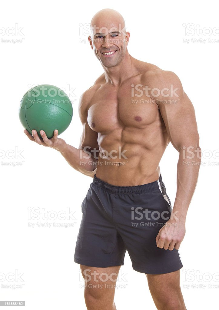 Handsome muscular man holding heavy weight ball royalty-free stock photo