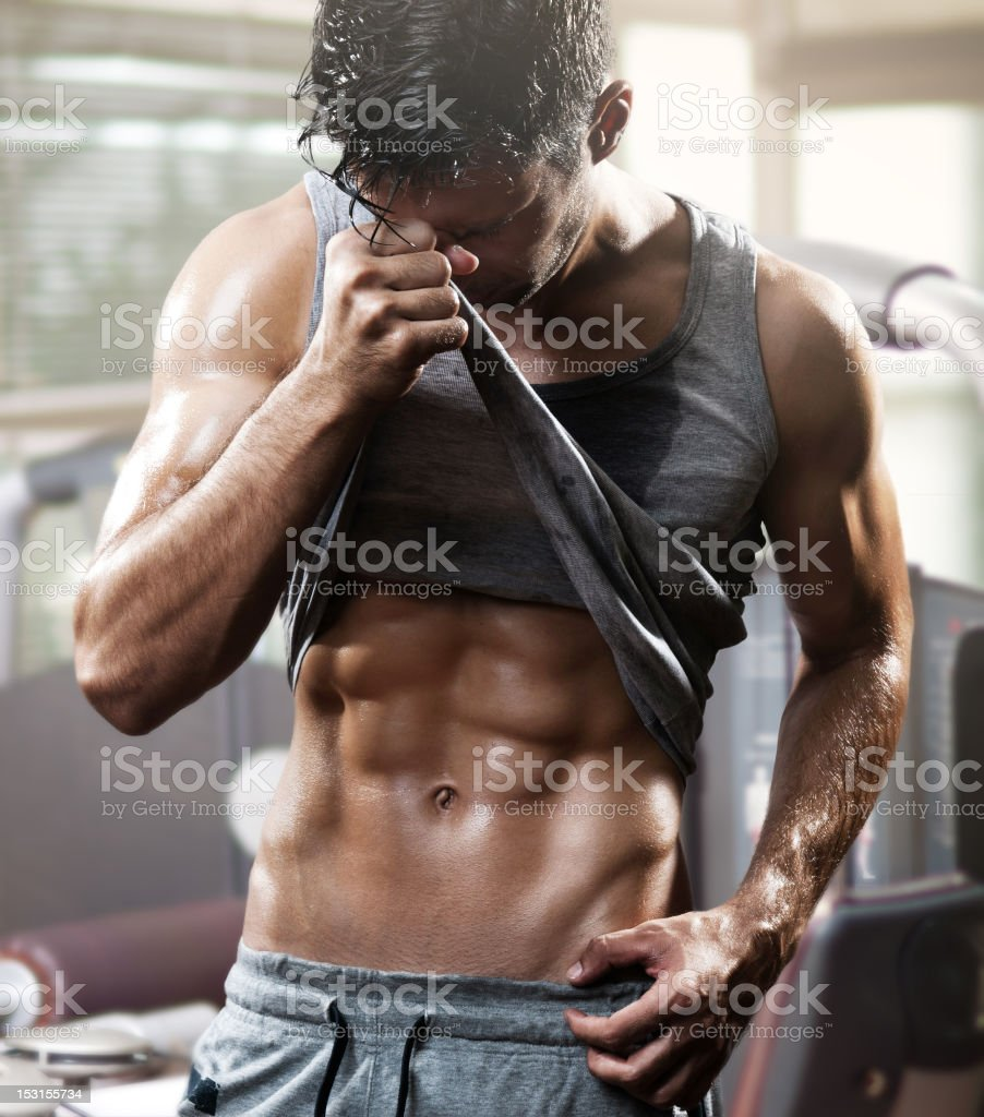 handsome muscular man in gym stock photo