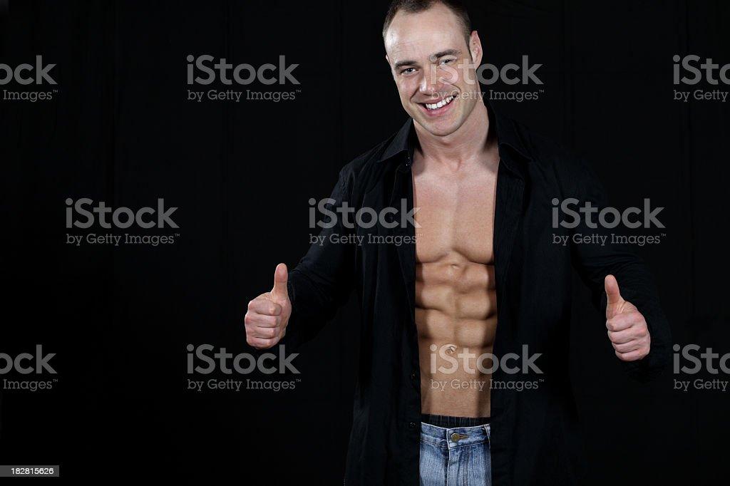 Handsome muscular man posing stock photo