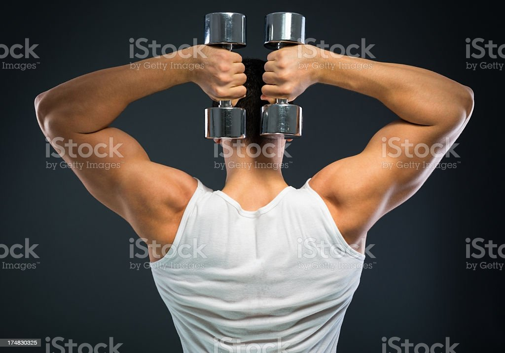 Handsome muscular man working out with weights. royalty-free stock photo