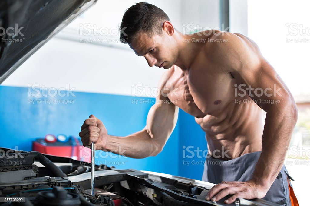 Handsome muscular mechanic stock photo