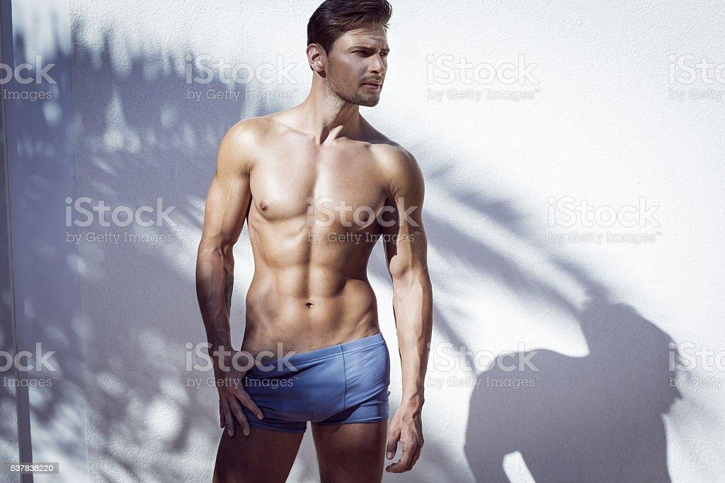 Handsome muscular model posing stock photo