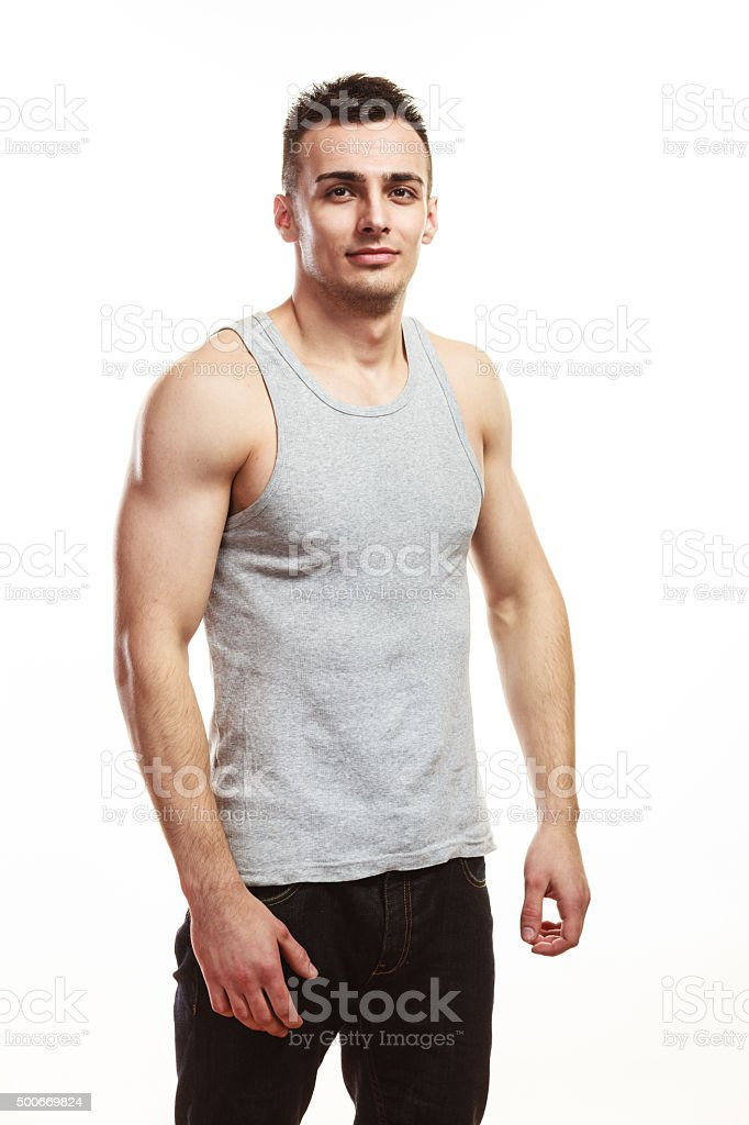 Handsome muscular sporty fit man isolated. stock photo