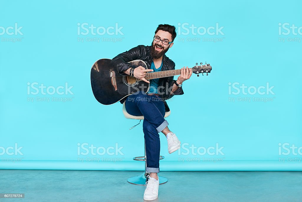 handsome musician playing guitar stock photo