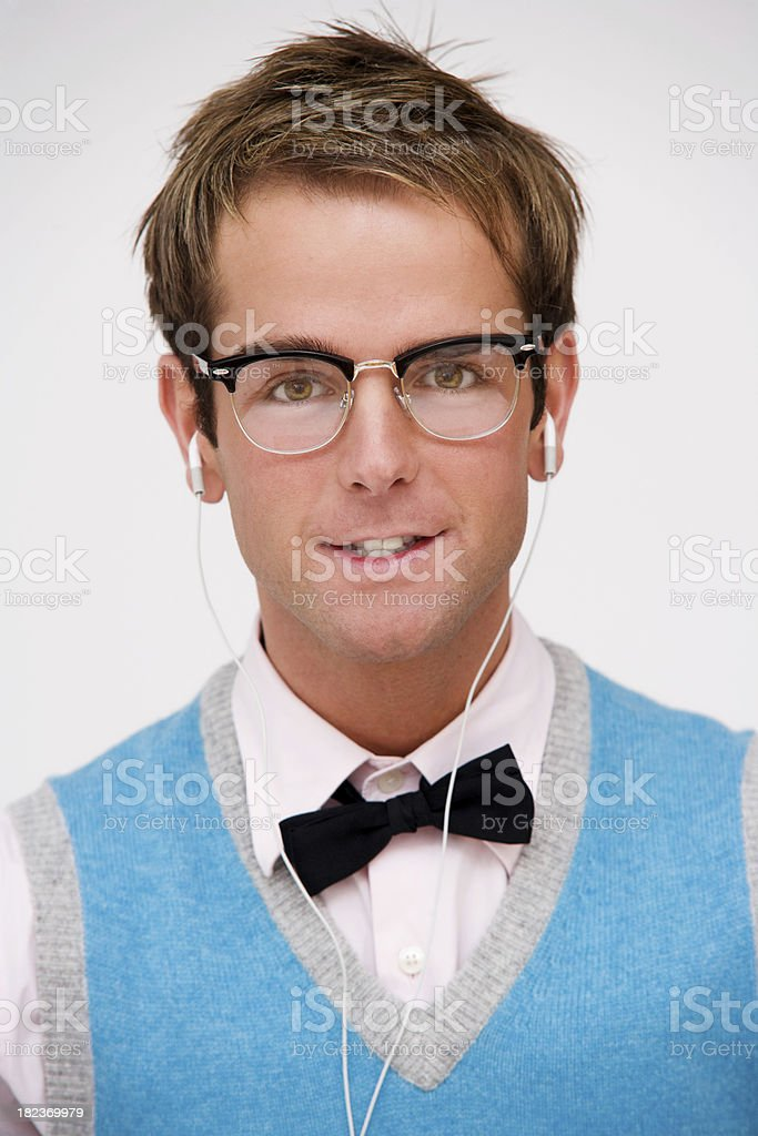 Handsome Nerd Sitting on a Chair Listening to Music royalty-free stock photo