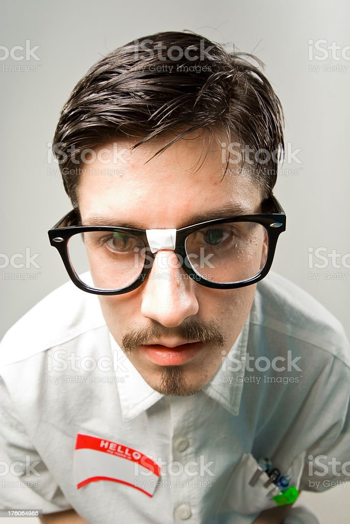 Handsome nerd with big head royalty-free stock photo