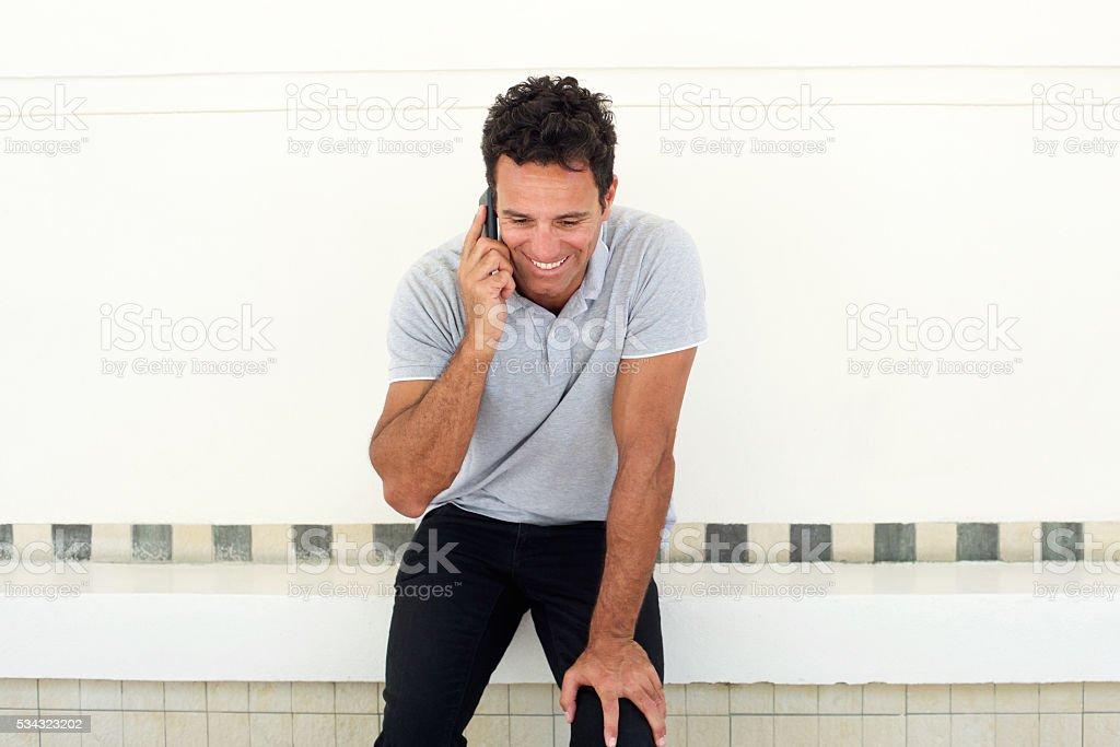 Handsome older man talking on mobile phone stock photo