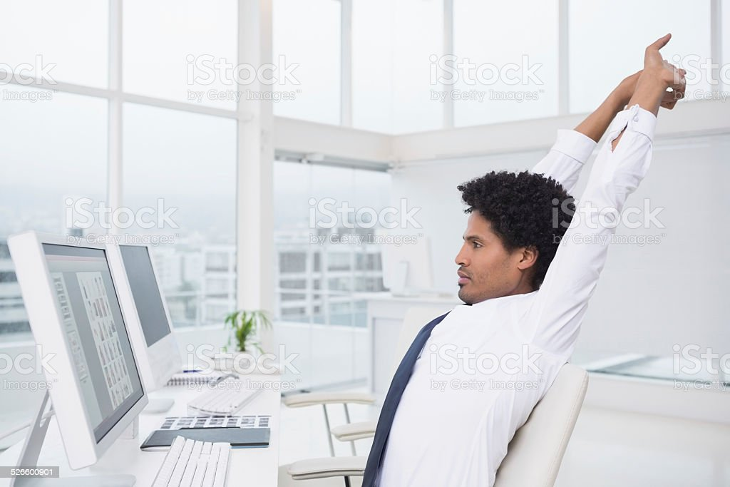 Handsome photo editor working at desk stock photo