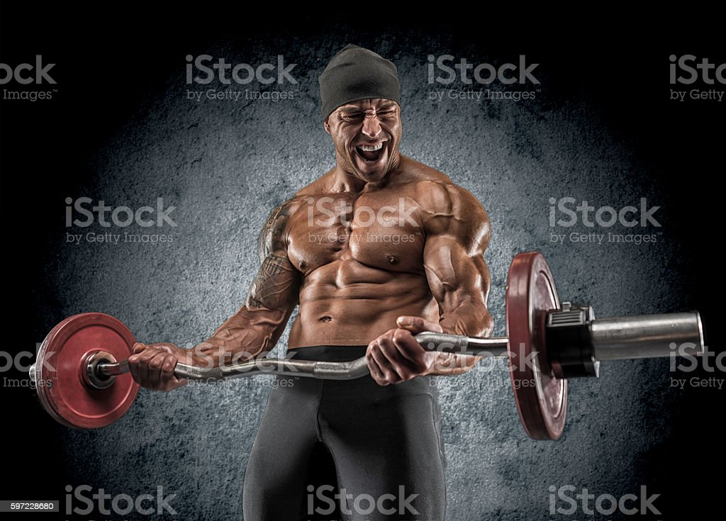 Handsome power athletic man bodybuilder doing exercises with bar stock photo