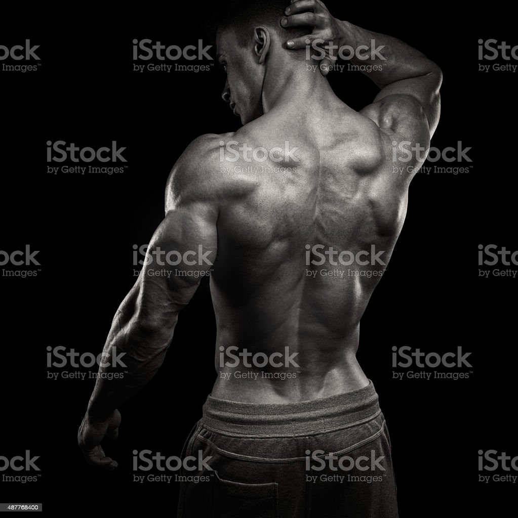 Handsome power athletic man turned back stock photo