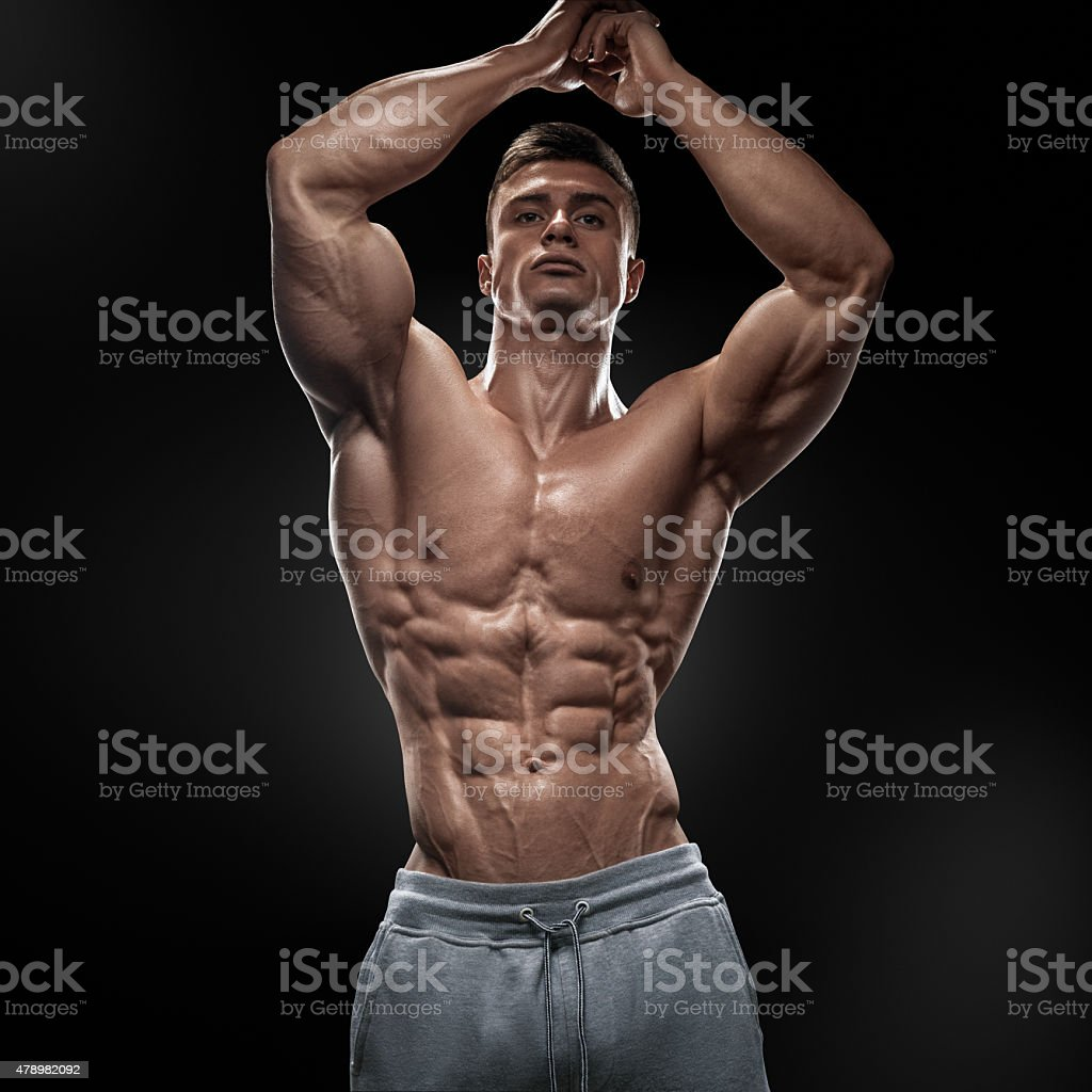 Handsome power athletic young man with great physique stock photo