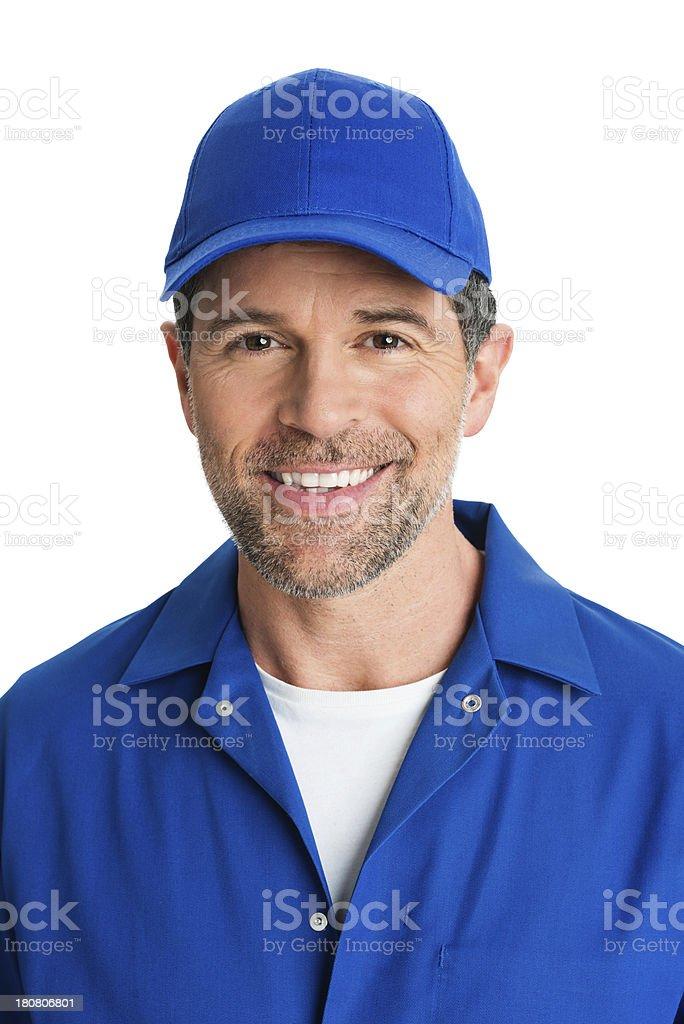Handsome Repairman In Blue Uniform Smiling stock photo