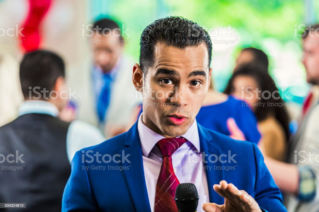 Handsome reporter on the news stock photo