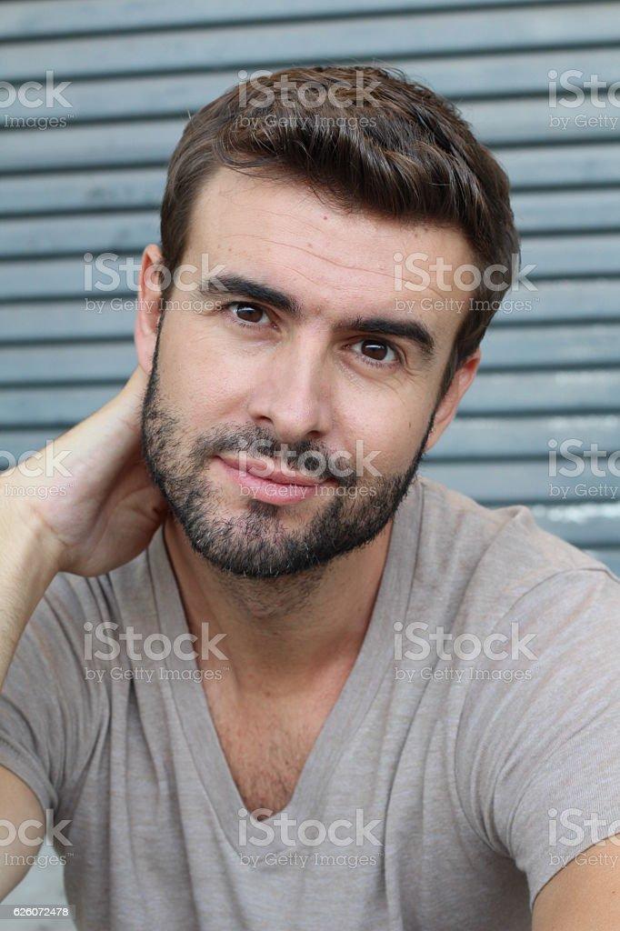 Handsome seductive man flirting at camera stock photo