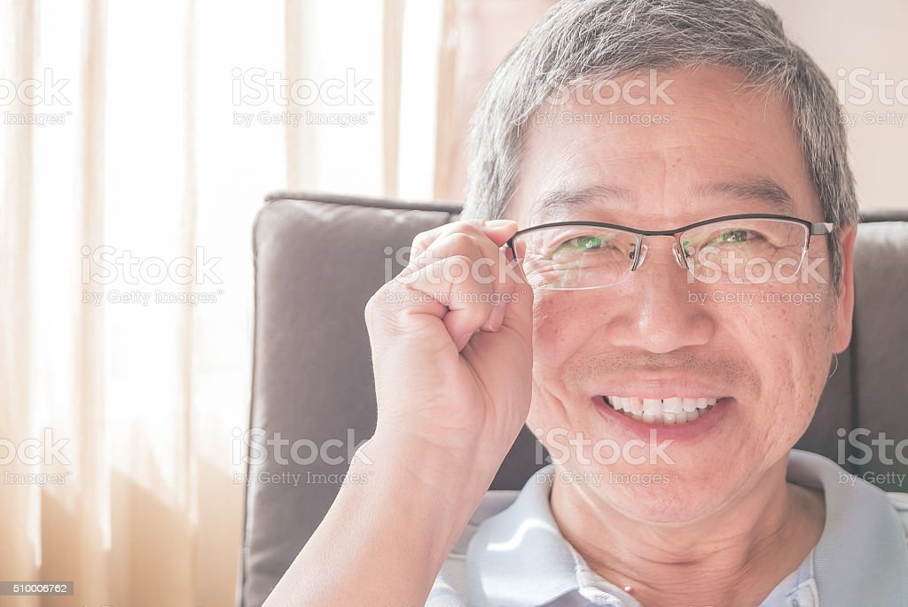handsome senior man with eyeglasses stock photo