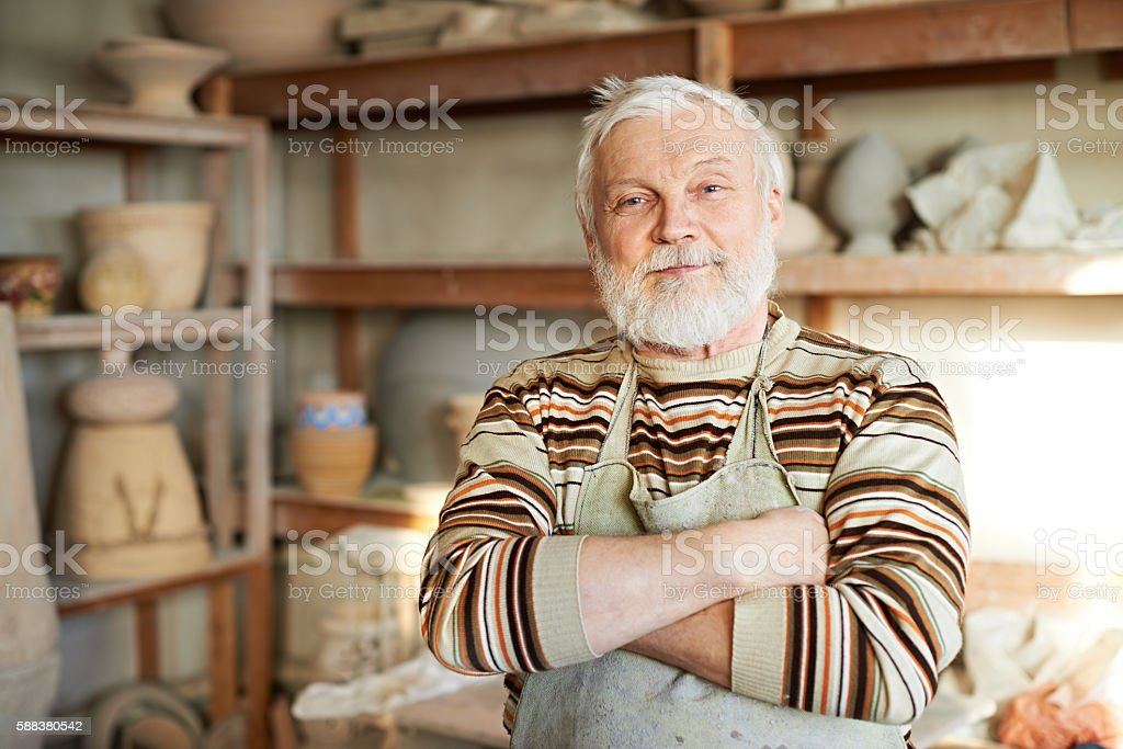 Handsome senior potter stock photo