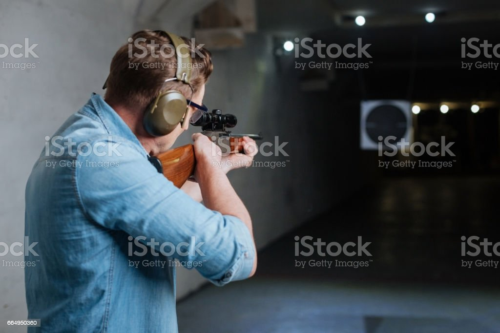 Handsome serious man looking at the target stock photo