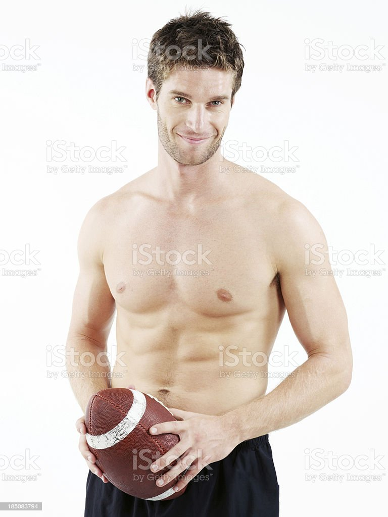 Handsome shirtless man holding a football smiling royalty-free stock photo