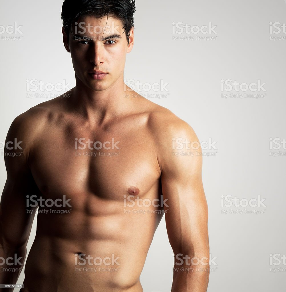 handsome shirtless man stock photo