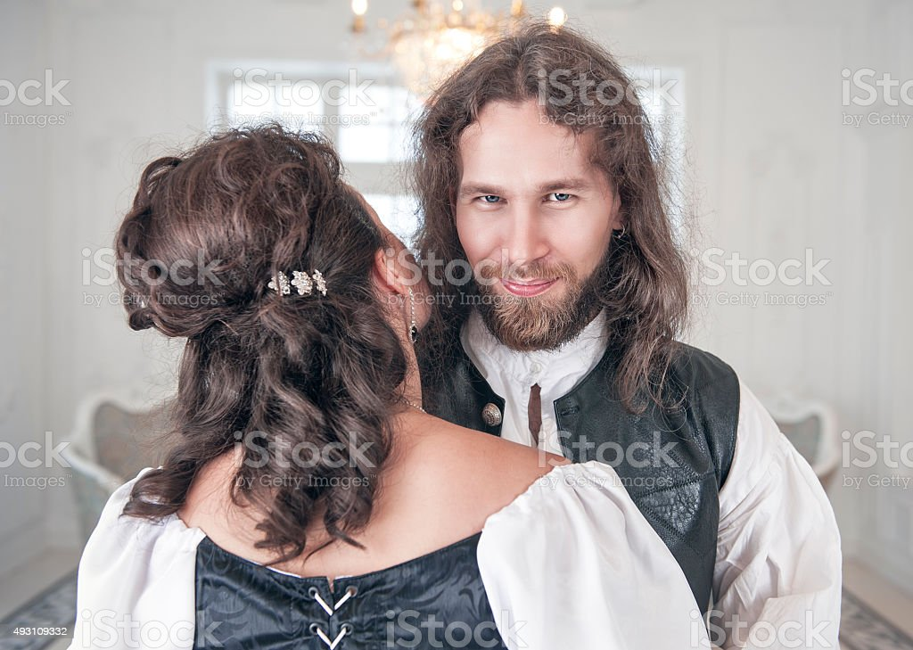 Handsome smiling man in medieval clothes with beautiful woman stock photo