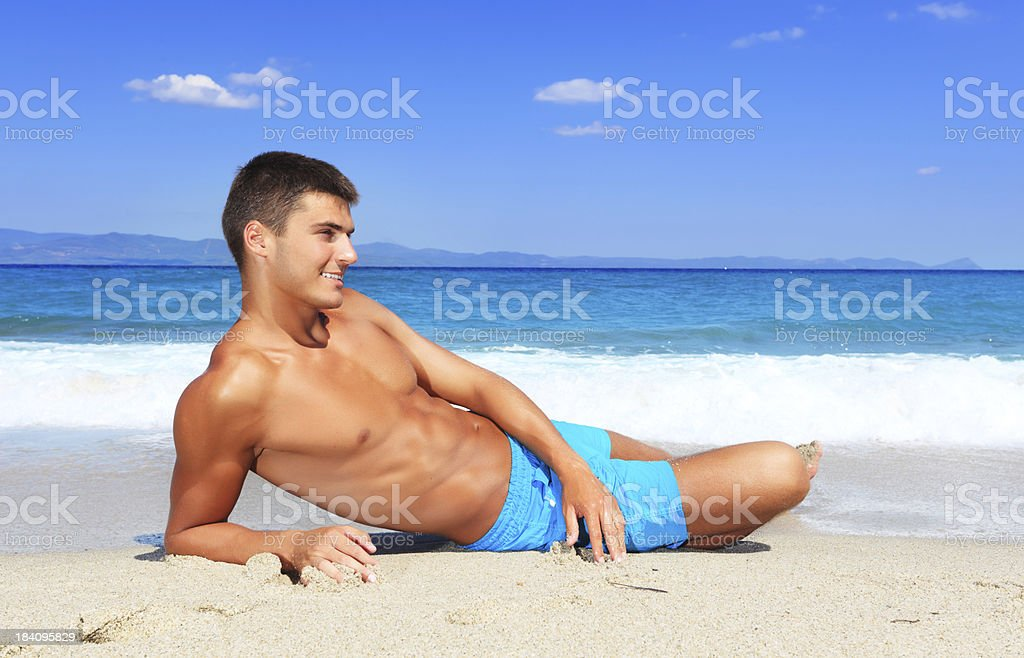 Handsome smiling man on the beach royalty-free stock photo